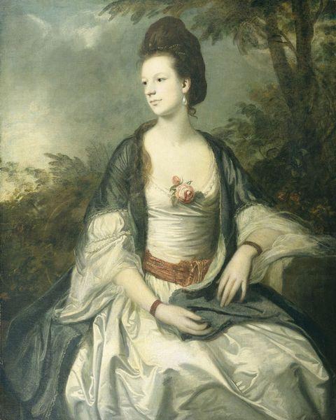 胸前戴花的贵夫人油画图片