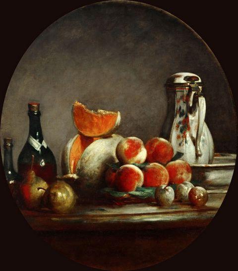 桌子上的瓶子和水果图片