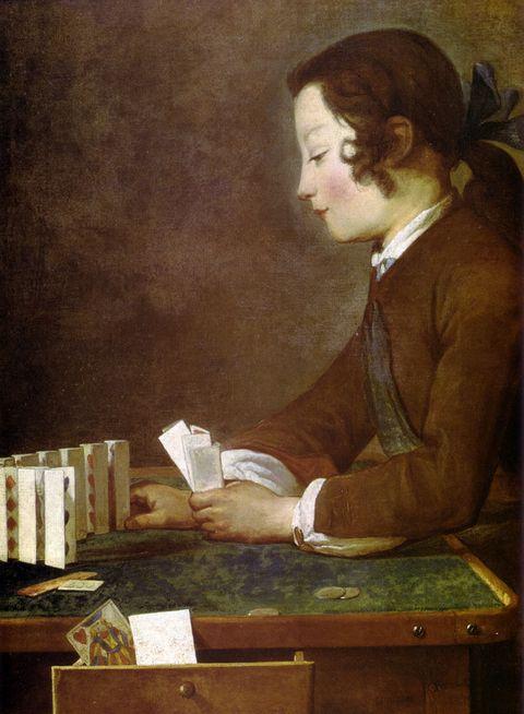 摆扑克的女孩图片