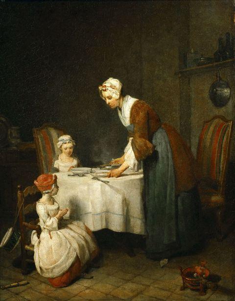饭桌前的孩子和女子图片